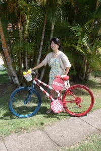 Sachie with her Art Bike: Women Get Fruits in a Basket
